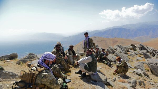 In this file photo taken on September 1, 2021, Afghan resistance movement and anti-Taliban uprising forces take rest as they patrol on a hilltop in Darband area in Anaba district of Panjshir province. - The Taliban said on September 6, 2021 the last pocket of resistance in Afghanistan, the Panjshir Valley, had been completely captured.  - Sputnik International