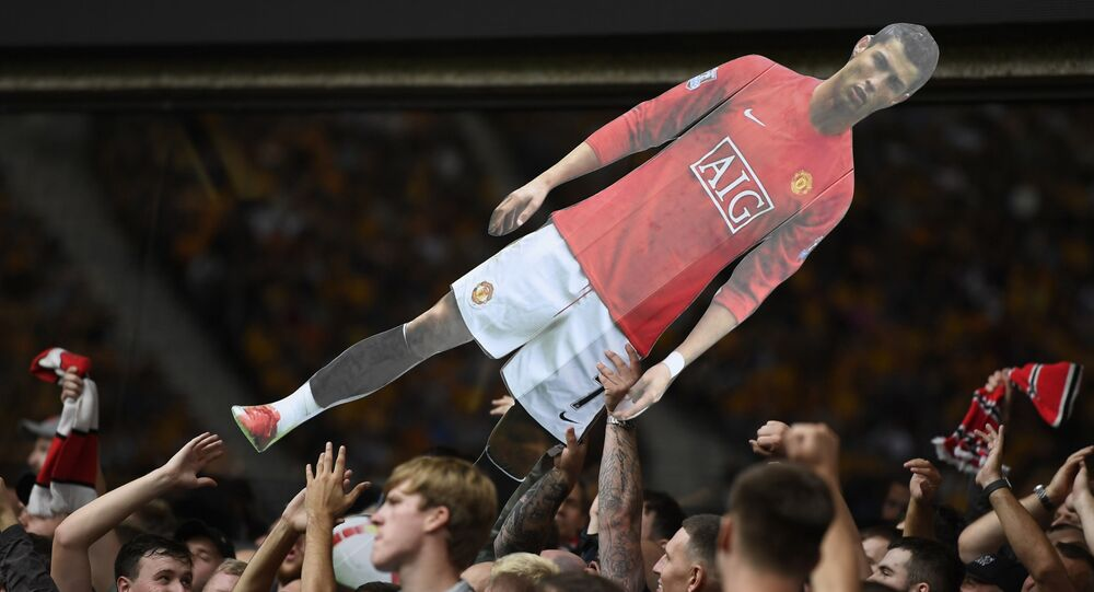 Soccer Football - Premier League - Wolverhampton Wanderers v Manchester United - Molineux Stadium, Wolverhampton, Britain - 29 August 2021 General view of Manchester United fans holding up a cardboard cut out of Cristiano Ronaldo