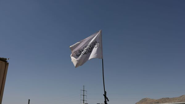 The flag of the Islamic Emirate of Afghanistan (Taliban) is raised at the military airfield in Kabul, Afghanistan, September 5, 2021. - Sputnik International