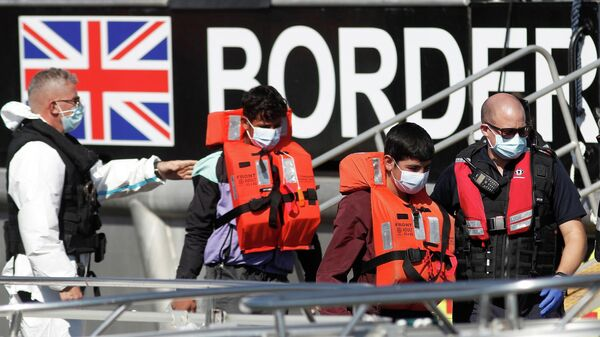 Migrants rescued from the English Channel are brought into Dover on the Border Force Catamaran Rescue Boat, BF Hurricane, Britain, September 8, 2021 - Sputnik International