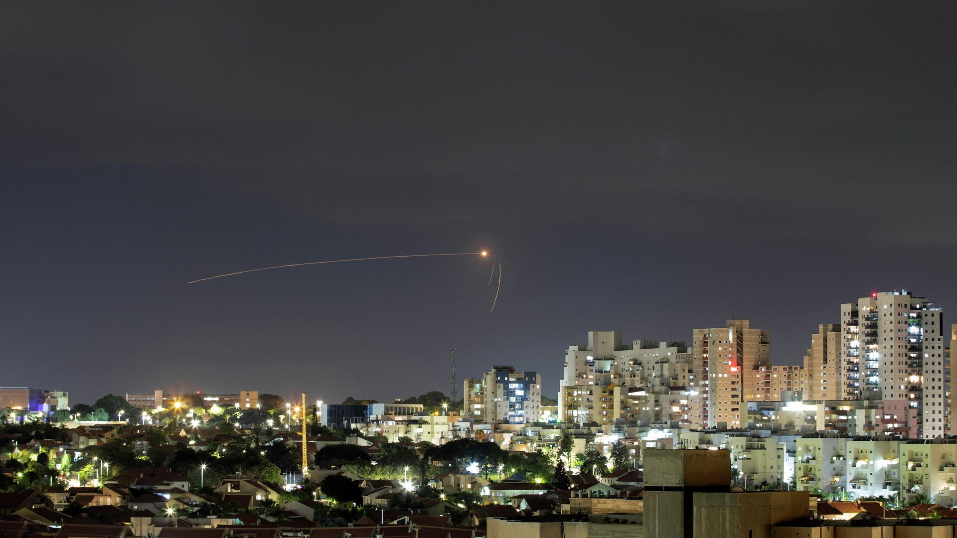 Streaks of light are seen as Israel's Iron Dome anti-missile system intercepts a rocket launched from the Gaza Strip towards Israel, as seen from Ashkelon, Israel September 11, 2021 - Sputnik International, 1920, 11.09.2021