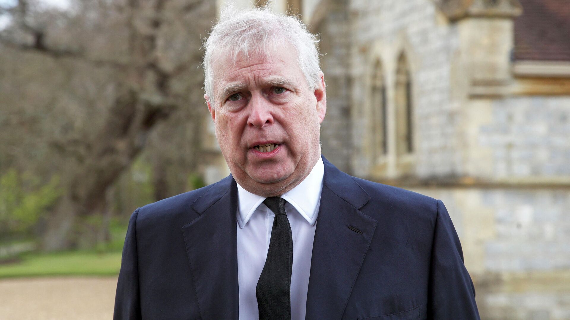 Britain's Prince Andrew, Duke of York, speaks during a television interview outside the Royal Chapel of All Saints in Windsor on April 11, 2021, two days after the death of his father Britain's Prince Philip, Duke of Edinburgh. - Sputnik International, 1920, 12.09.2021