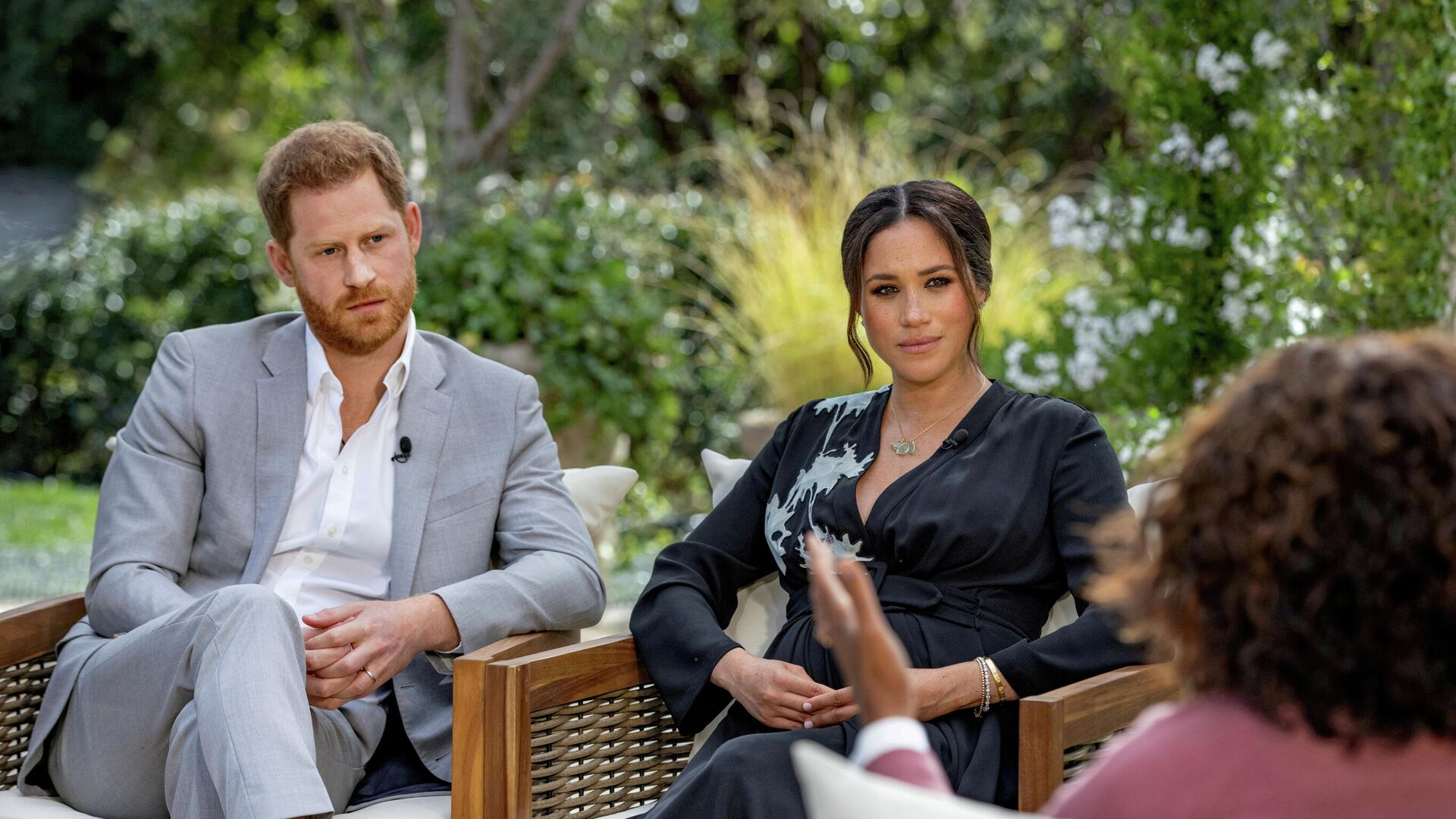 Britain's Prince Harry and Meghan, Duchess of Sussex, are interviewed by Oprah Winfrey in this undated handout photo - Sputnik International, 1920, 13.09.2021