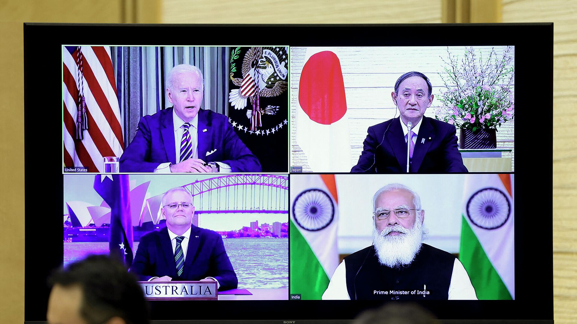 A monitor displaying a virtual meeting with U.S. President Joe Biden (top L), Australia's Prime Minister Scott Morrison (bottom L), Japan's Prime Minister Yoshihide Suga (top R) and India's Prime Minister Narendra Modi is seen during the virtual Quadrilateral Security Dialogue (Quad) meeting, at Suga's official residence in Tokyo on March 12, 2021. - Sputnik International, 1920, 14.09.2021