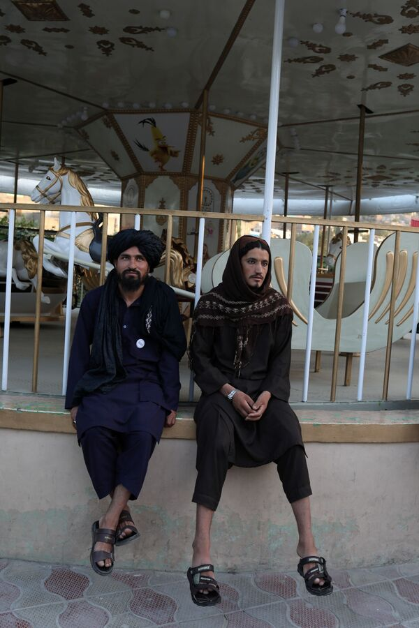 Taliban soldiers sit in an amusement park in Kabul, Afghanistan, 13 September 2021.  - Sputnik International