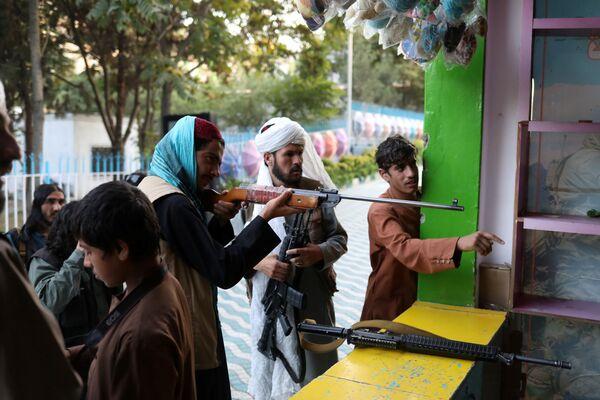 A Taliban soldier shoots at an amusement park in Kabul, Afghanistan, 8 September 2021.  - Sputnik International