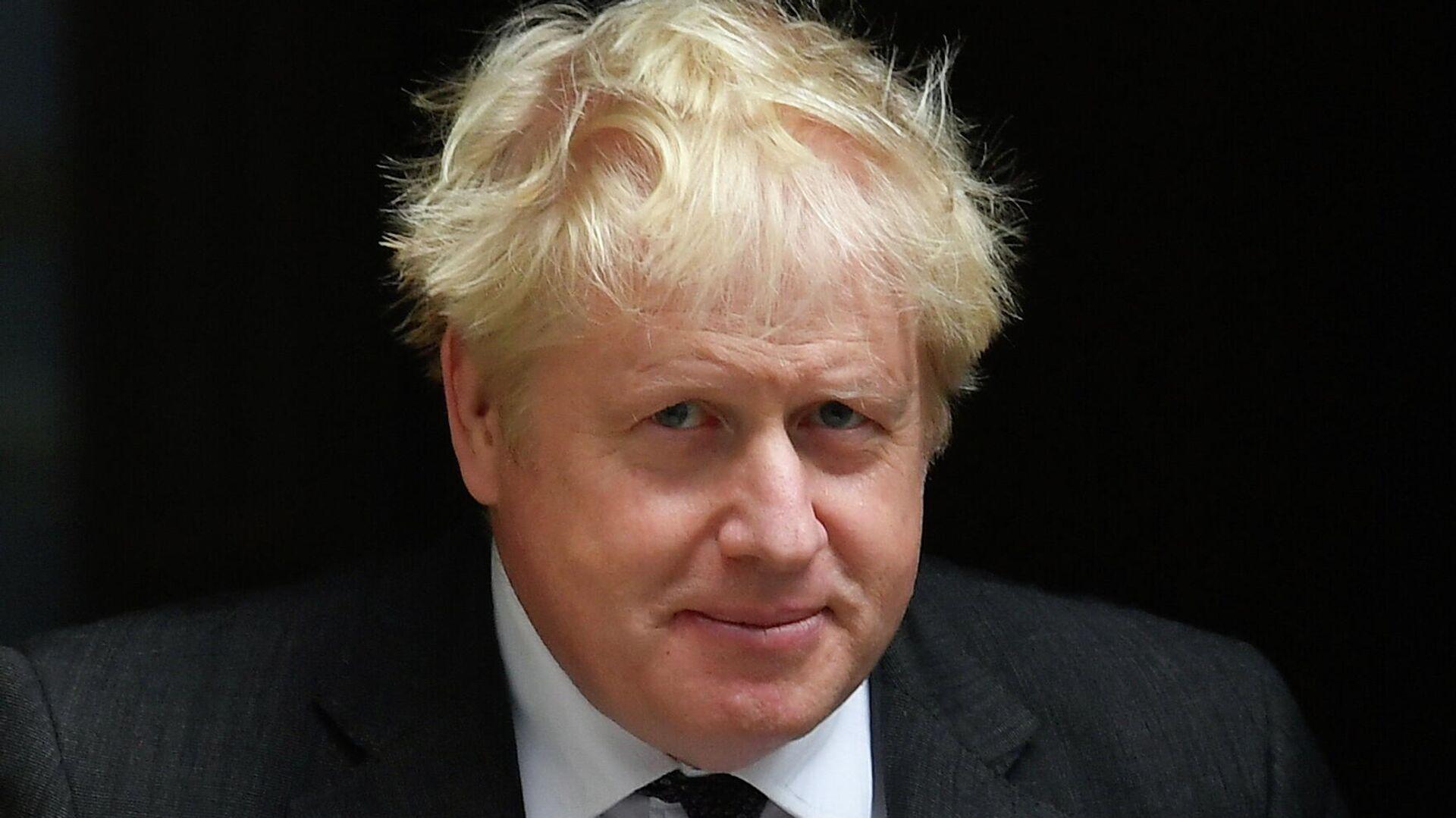 Britain's PM Johnson walks outside Downing Street in London - Sputnik International, 1920, 15.09.2021