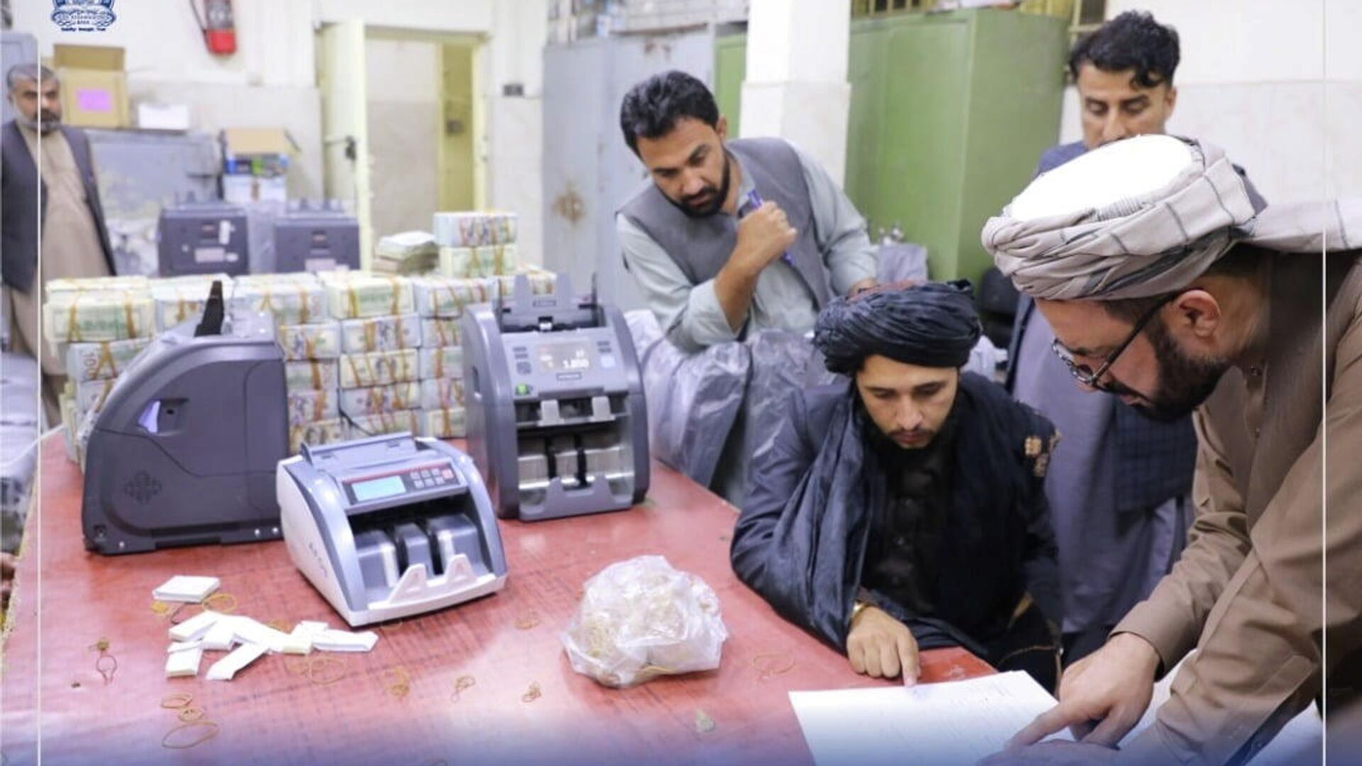 Men are pictured as Afghanistan's Taliban-controlled central bank seizes a large amount of money in cash and gold from former top government officials, including former vice president Amrullah Saleh, in Afghanistan, in this handout obtained by Reuters on September 15, 2021 - Sputnik International, 1920, 15.09.2021