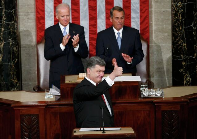 Ukraine President Petro Poroshenko gestures while addressing a joint meeting of Congress in the U.S. Capitol in Washington, September 18, 2014