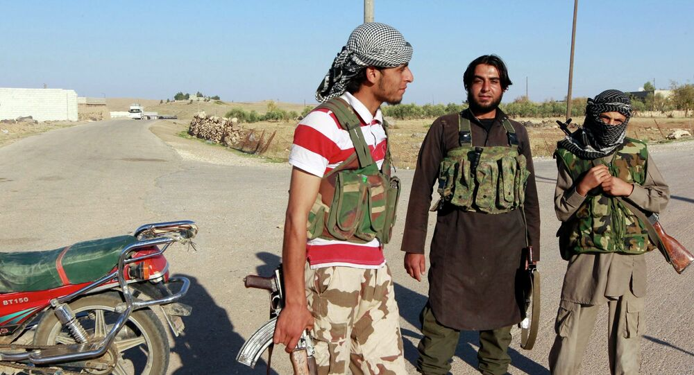 Islamic State fighters stand along a street in the countryside of the Syrian Kurdish town of Kobani.