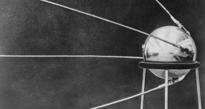 This first official picture of the Soviet satellite Sputnik I was issued in Moscow October 9, 1957, showing the four-antennaed satellite resting on a three-legged pedestal.