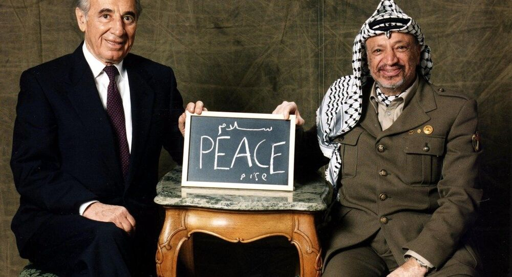 Arafat and Shimon Peres acknowledging winning the Nobel Peace Prize in 1994 for their efforts to create peace in the Middle East
