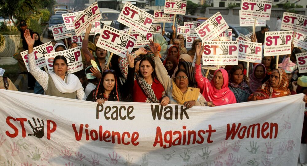 Pakistani women rally to condemn violence against women, Monday, Dec. 9, 2013 in Lahore, Pakistan. Azra Shad, an official of the Women Workers Helpline organization, said violence against women in Pakistani society is rampant and the government seems unmoved to halt this increasing trend against women who are a common subject to social, economic, physical and sexual violence in the society.