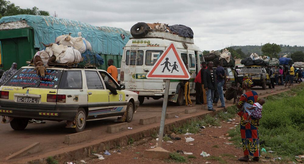 Cars line up to enter Guinea from Mali at the border in Kouremale