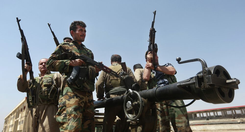 Kurdish peshmerga fighters take positions on the front line with militants from the al-Qaida-inspired Islamic State in Iraq and the Levant (ISIL), in Tuz Khormato, 100 kilometers (62 miles) south of the oil rich province of Kirkuk, northern Iraq, Wednesday, June 25, 2014