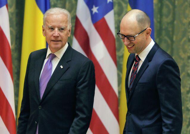 US Vice President Joe Biden, left, talks with Ukrainian Prime Minister Arseniy Yatsenyuk during a meeting in Kiev, Ukraine, Friday, November 21, 2014.
