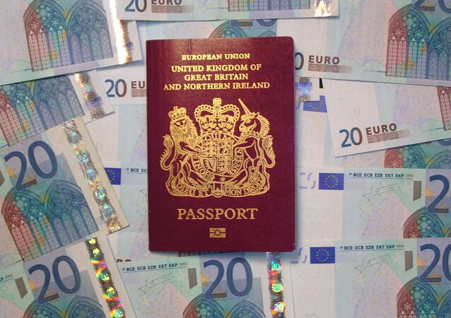 UK biometric passport on pile of Euro currency