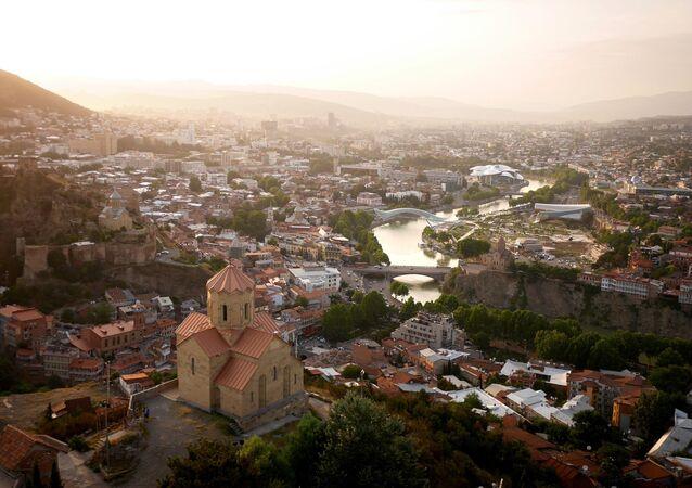 The Mtkvari River winding through Tbilisi, Georgia
