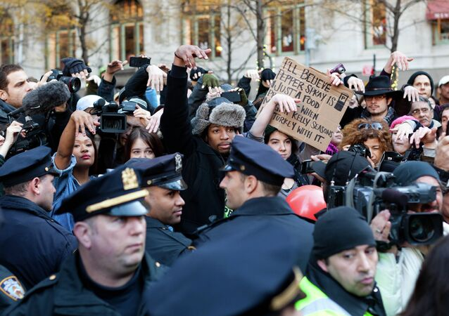 Occupy Wall Street protestors show they disapprove of police demanding that drums not be played in Zuccotti park due to a noise complaint from nearby residents on Thanksgiving day, Thursday, Nov. 24, 2011, in New York. Although the crowd insisted they had a right to play, the drummer in question opted to refrain from playing to avoid a confrontation with police.