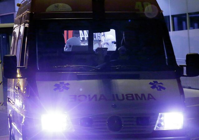 An ambulance carrying Cuban doctor Felix Baez leaves Cointrin airport in Geneva November 21, 2014. A Cuban doctor, identified by Cuban officials as Felix Baez, who was infected with Ebola in Sierra Leone, was flown to Switzerland for treatment at the University Hospital in Geneva (HUG). Baez is one of 165 Cuban doctors and nurses treating Ebola patients in Sierra Leone and is the first of the group, deployed since early October, who is known to be infected by the virus that has killed more than 5,400 people