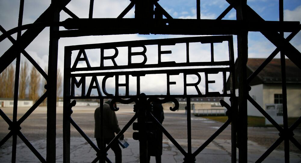 The main gate of the former Dachau concentration camp with the sign Arbeit macht frei (work sets you free) is seen in Dachau, near Munich, in this January 25, 2014 file picture.