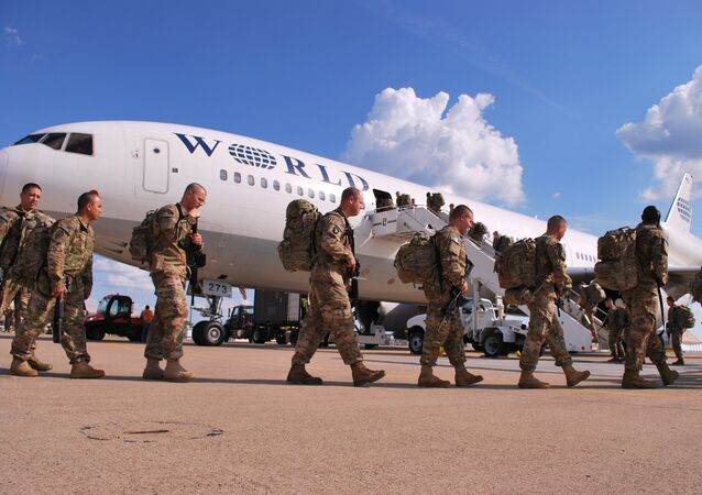 Soldiers from the 101st Airborne Division line up on Wednesday, May 8, 2013 to board a plane at Fort Campbell, Ky., to go to Afghanistan