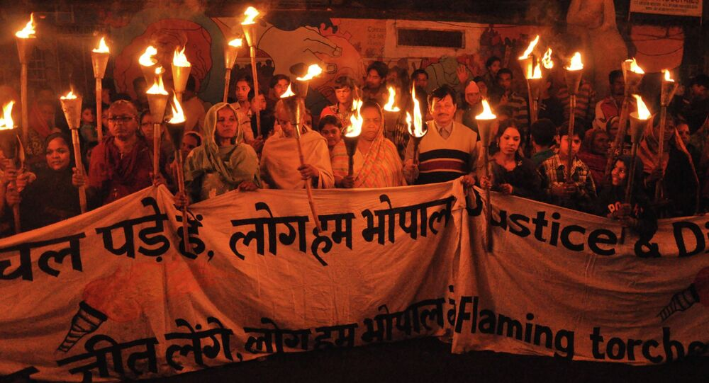 Clean up the mess! Survivors and their supporters take part in a torchlight protest rally calling for justice on the 29th anniversary of the Bhopal Gas Disaster.