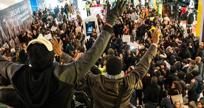 Hundreds stage 'die-in' protest in UK's Westfield mall over Eric Garner death