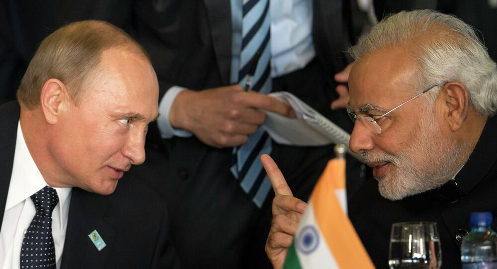 Russia's President Vladimir Putin, left, and India's Prime Minister Narendra Modi chat during the BRICS Summit at the Itamaraty Palace, in Brasilia, Brazil, Wednesday, July 16, 2014