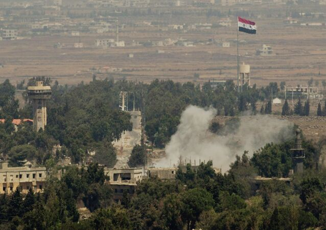Smoke rises following a Syrian strike in Syria's old city of Quneitra near the border crossing between Syria and the Israeli-controlled Golan Heights