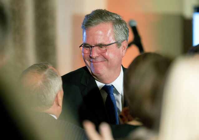 Former Florida Gov. Jeb Bush talks to supporters after speaking at the U.S. Cuba Democracy PAC's 11th Annual Luncheon in Coral Gables, Fla.