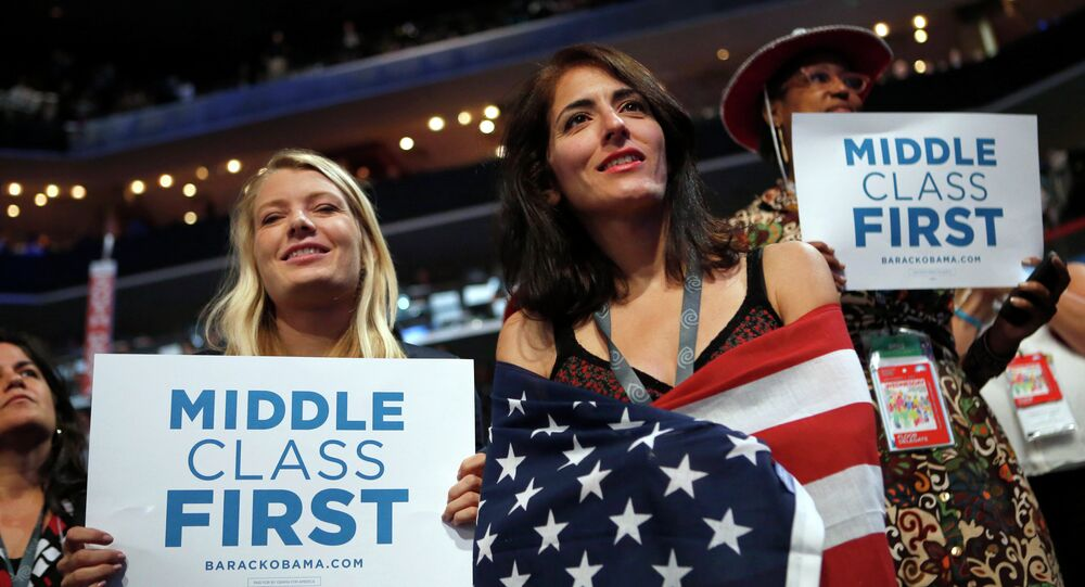 In this Sept. 5, 2012, file photo, delegates watch as former President Bill Clinton addresses the Democratic National Convention in Charlotte, N.C. Since 2008, the number of people who call themselves middle class has fallen by a fifth, according to a survey in January 2014 by the Pew Research Center, from 53 percent to 44 percent.