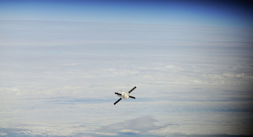Backdropped by a cloud-covered part of Earth, the European Space Agency's Johannes Kepler Automated Transfer Vehicle-2 (ATV-2) approaches the International Space Station.