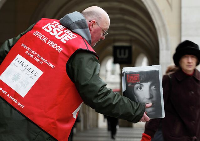 Big Issue seller in the street near Charing Cross in central London