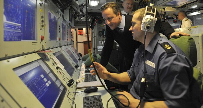 British Prime Minister David Cameron (L) visits the Trident Nuclear Submarine, HMS Victorious