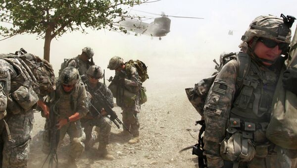 US Soldiers wait for the CH-47 Chinook helicopter to land so they can depart from an air-assault mission during Operation Champion Sword to search Khost province, Afghanistan, July 28, 2009. Afghan national security forces and International Security Assistance Forces teamed up to focus on specific militant targets and safe havens within Sabari and Terezai districts. - Sputnik International