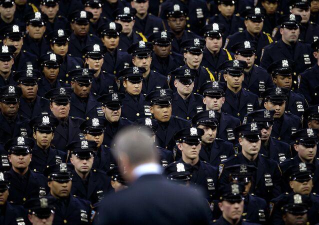 New York Mayor Bill de Blasio speaks from the podium to the New York City Police Academy Graduating class in New York December 29, 2014.