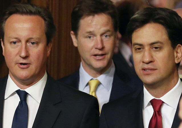 British Prime Minister David Cameron, left, Deputy Prime Minister and leader of the Liberal Democrats Nick Clegg, centre, and Leader of the Labour Party Ed Miliband.
