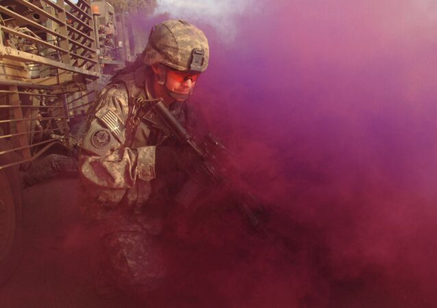 A U.S. Army Soldier from the 3rd Squadron, 2nd Stryker Cavalry Regiment conceals himself with smoke Oct. 18, 2007, after one of his regiment\'s vehicles was hit by an improvised explosive device in Baghdad, Iraq.