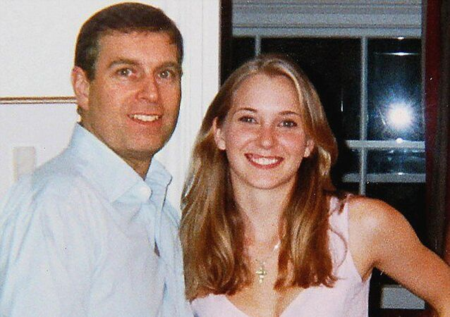 Prince Andrew is seen with Virginia Roberts during a visit to New York with Andrew's friend and alleged pimp Jeffrey Epstein