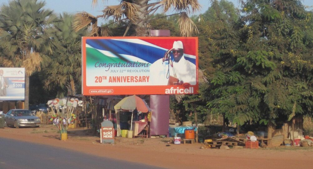 A giant billboard of President Yahya Jammeh, of the Gambia, sits on an empty street in Banjul.