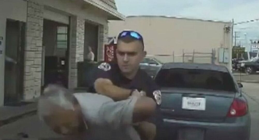 Victoria police officer Nathanial Robinson pushed 76-year old Pete Vasquez onto the hood of the police car.