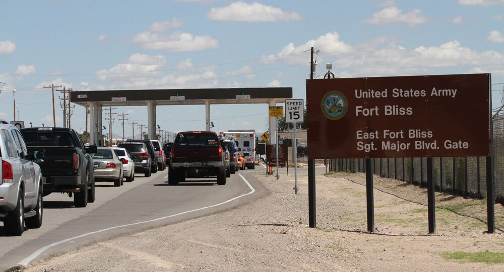 Cars wait to enter Fort Bliss in El Paso, Texas, Tuesday Sept. 9, 2014