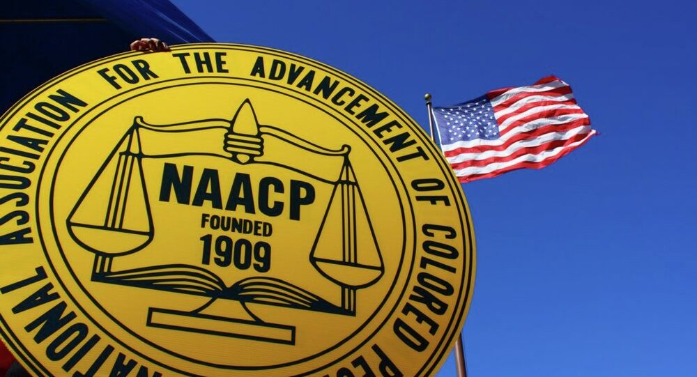 Investigators are searching for a man in connection with a bombing outside of the NAACP Colorado Springs chapter.