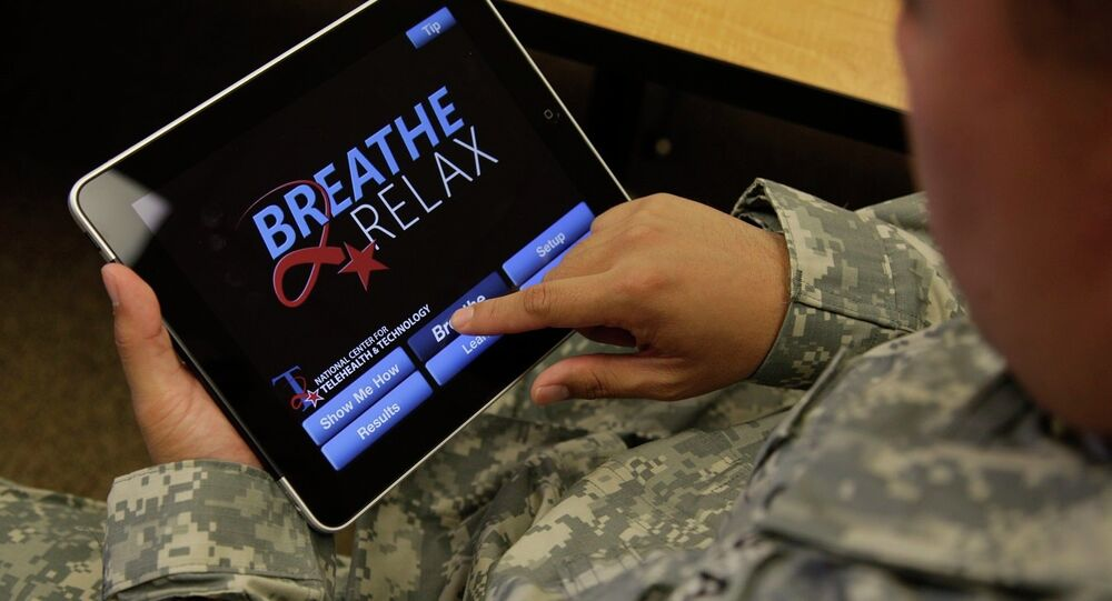 Sgt. Mark Miranda, a public affairs specialist stationed at Joint Base Lewis-McChord in Washington state, demonstrates the use of a program for tablet computers and smart phones that is designed to help calm symptoms of post-traumatic stress and traumatic brain injury, Friday, July 22, 2011. Miranda said he does not suffer from PTSD, but after trying the app, he said he may suggest its use to other soldiers who he has deployed with.