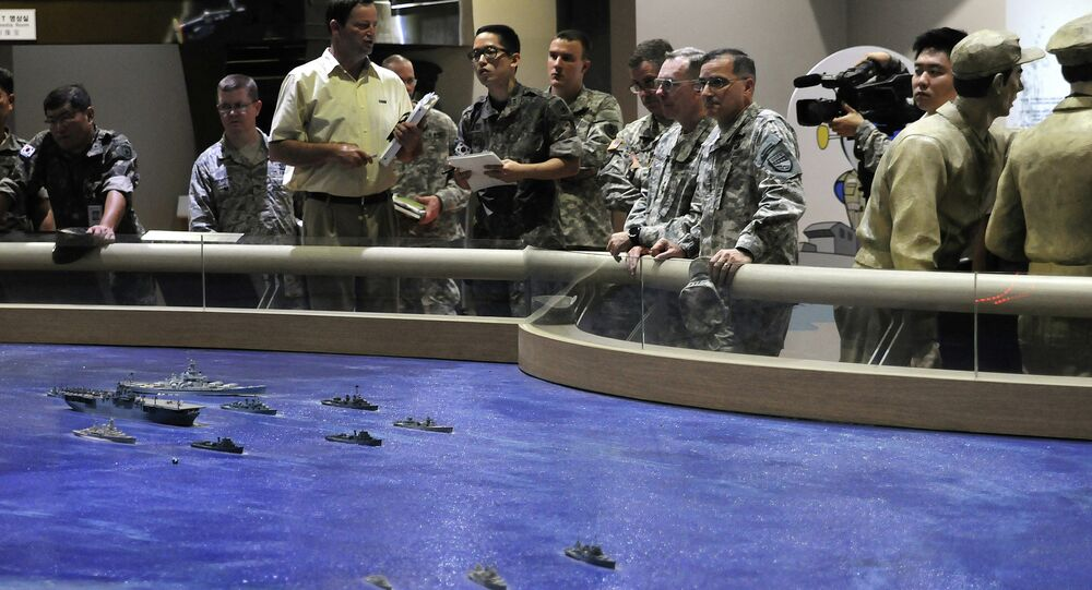 US military officers plan out combined training drills with South Korean military representatives on July, 15, 2014.