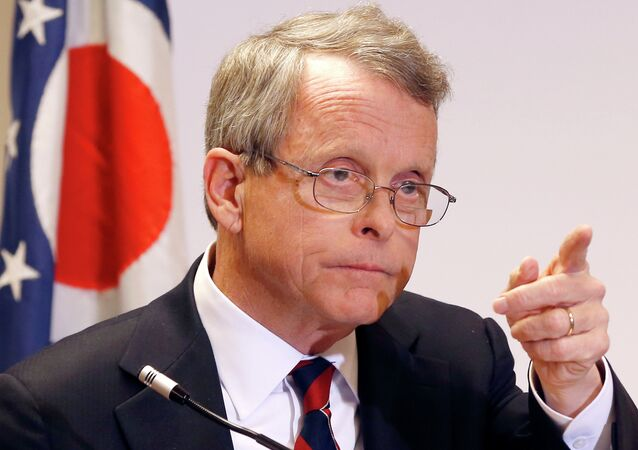Ohio Attorney General Mike DeWine takes a question at a news conference where he announced indictments against four additional people in relation to the 2012 rape of a high school student on Monday, Nov. 25, 2013 in Steubenville, Ohio.