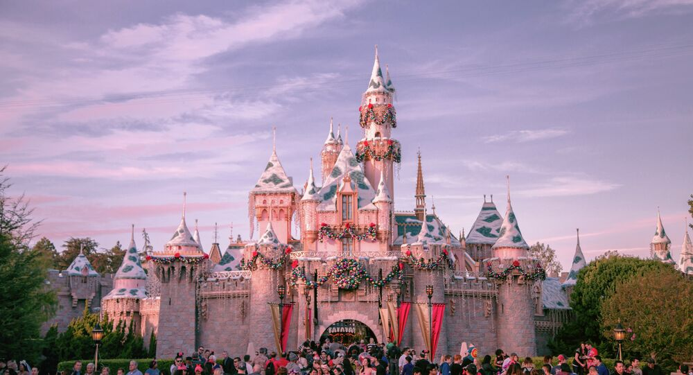 Tens of thousands of tourists flood into Disneyland resort each day during the Christmas season to enjoy holiday decorations and magical events.