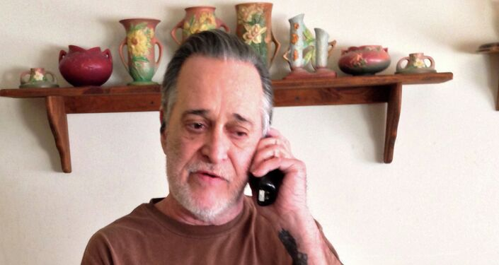John Cornell, father of Christopher Lee Cornell, talks on the phone at his home, Thursday, Jan. 15, 2015, in Green Township, Ohio. His son Christopher, also known as Raheel Mahrus Ubaydah, told an FBI informant they should wage jihad, and showed his plans for bombing the Capitol and shooting people, according to a criminal complaint filed in federal court in Ohio on Wednesday.