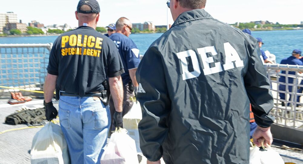Members from the Coast Guard, Drug Enforcement Agency, Massachusetts State Police and other local and federal law-enforcement agencies offload more than 1,200 pounds of cocaine from the deck of the Coast Guard Cutter Dependable, Sept. 6, 2013.